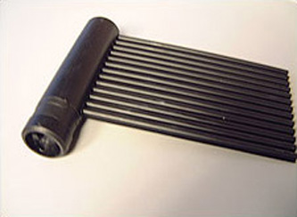 Photo of a black solar collector attached to a tube-shaped header pipe