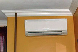 View of split ductless HVAC system inside apartment.