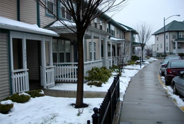 a street view illustrating zero-step entrances in a snowy climate
