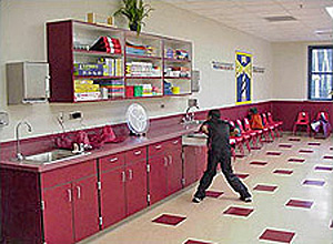 Child in front of red cabinets in the arts-and-crafts-style activity room at the youth center, naval station Mayport